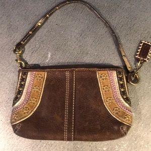 Brown leather coach clutch/ wristlet